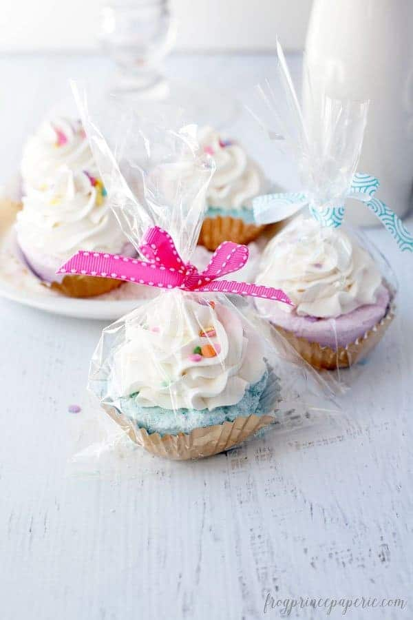 fizzy bath bombs in the shape of cupcakes wrapped in cellophane with a bow ribbon