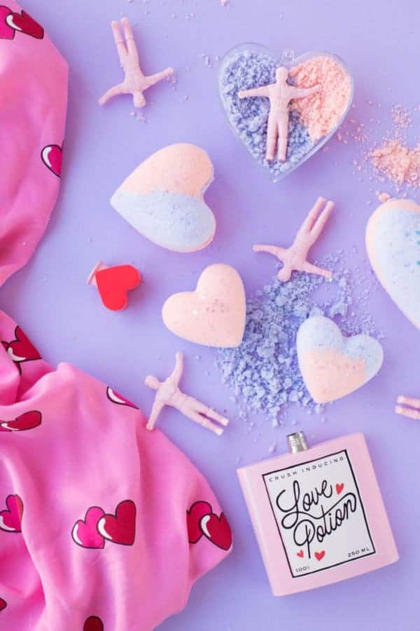 Bath bomb image with hearts, stretch men and a bottle of love potion