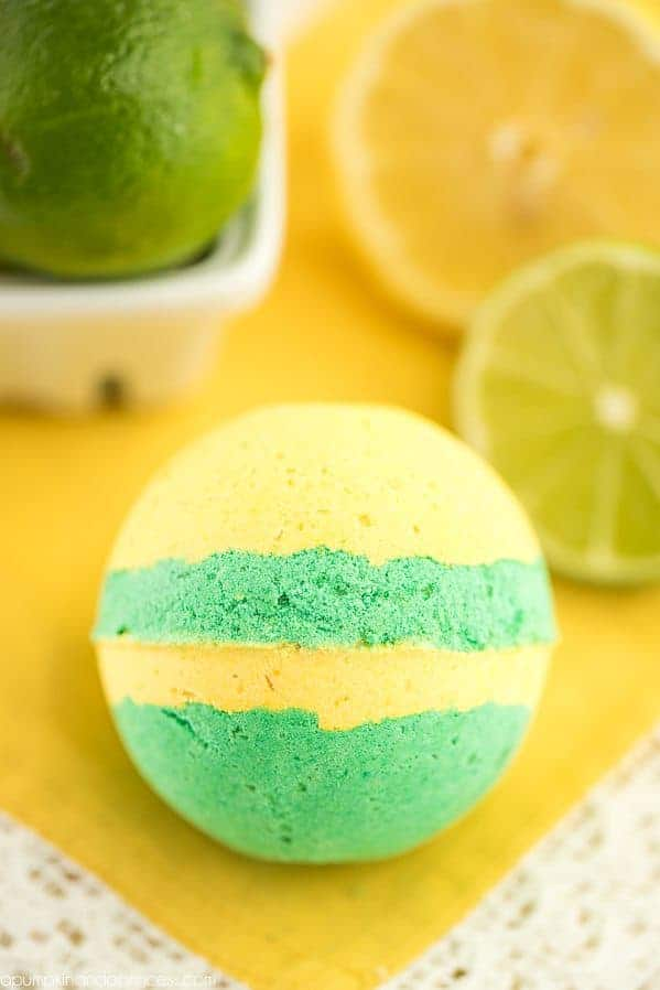 round bath bomb with yellow and green stripes.