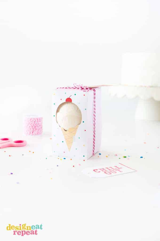 Bath bomb in a white polka dot box with a red ribbon and a cut out shaped as an ice cream
