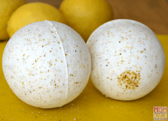 white bath bomb with yellow speckles and lemons in the background