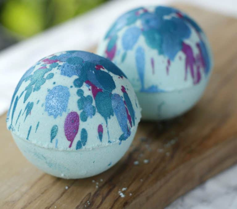 blue bath bombs with blue, green. and purple spots