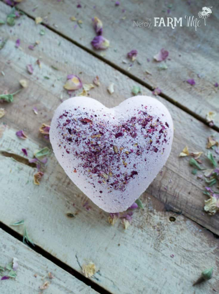 white heart shaped bath bomb with rose sprinkles