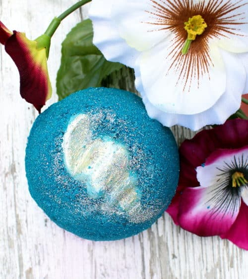 Bright blue bath bomb with large flowers