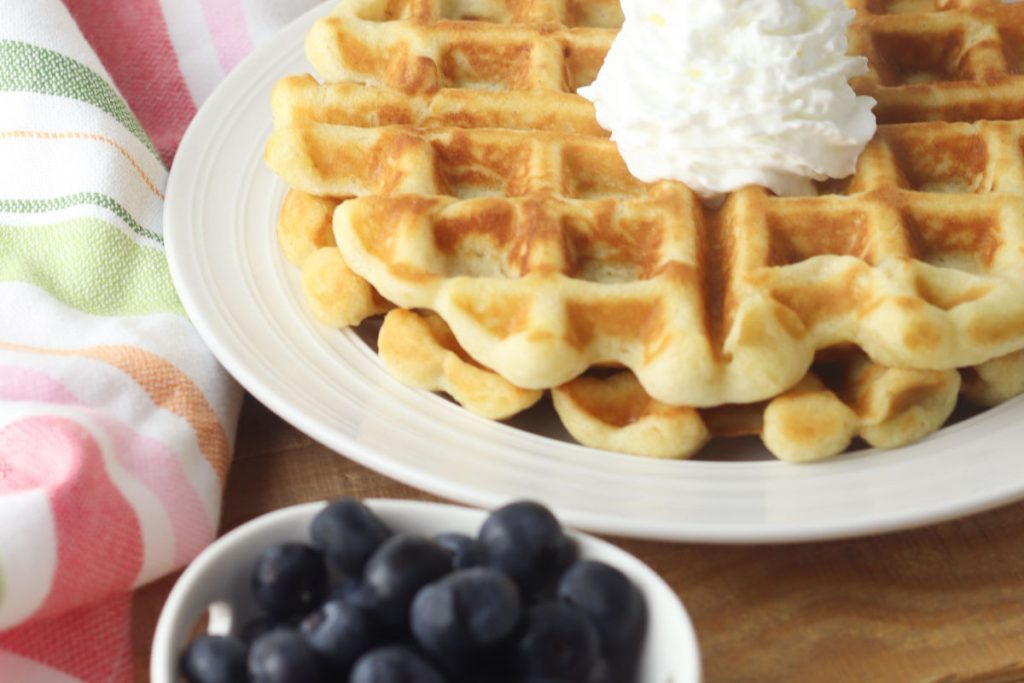 gluten-free belgian waffles with cream and blueberries