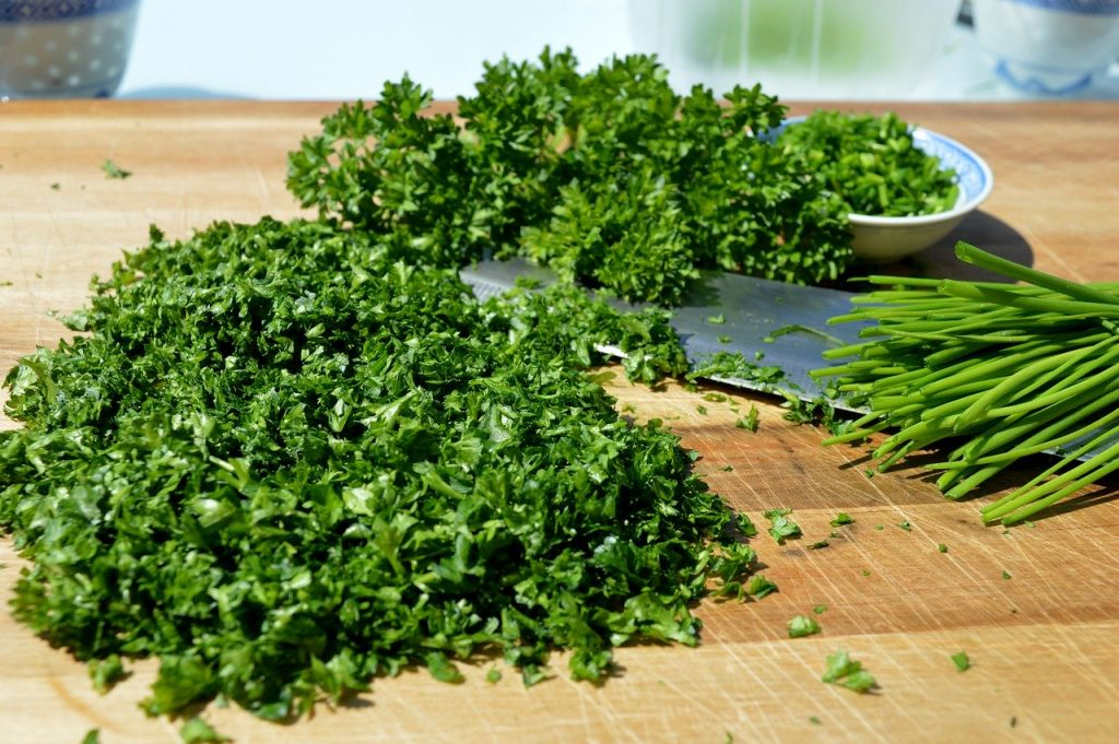 Freshly chopped parsley and knife