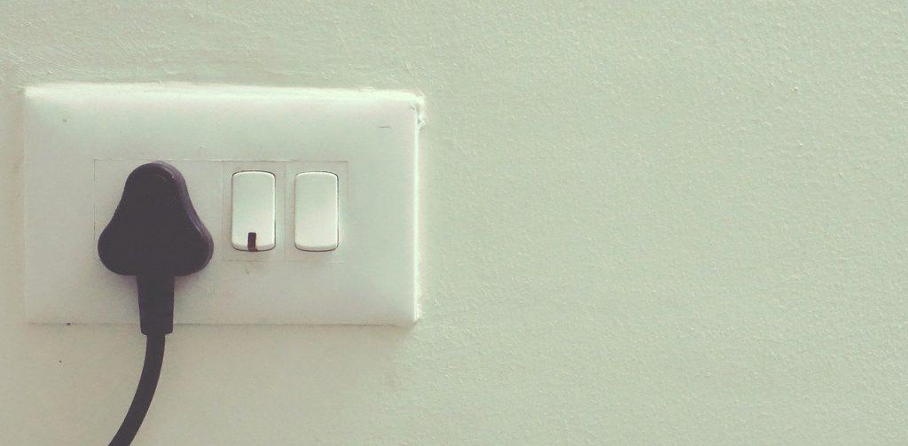 Plug socket with black plug