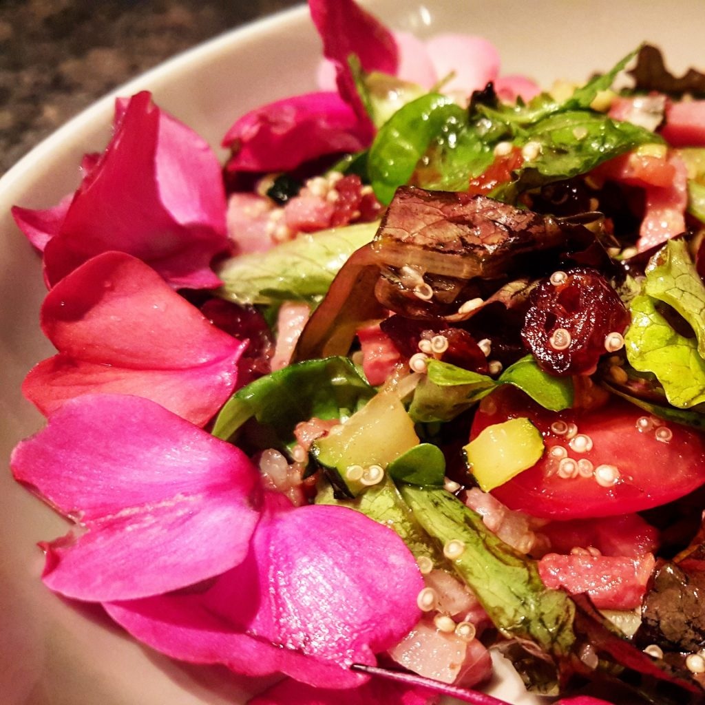 Vegetable salad decorated with pink petals