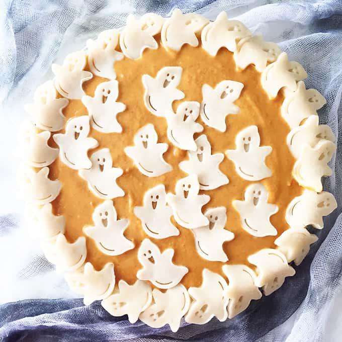 Halloween pumpkin pie with decorative ghosts