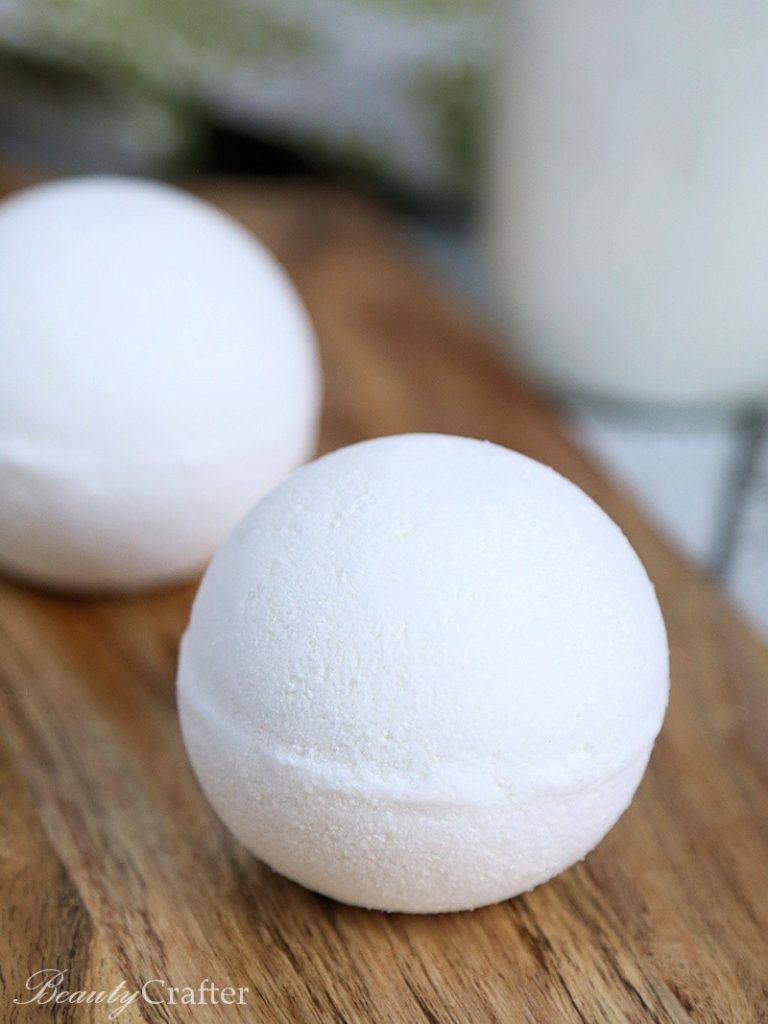 white bath bombs on a wooden table